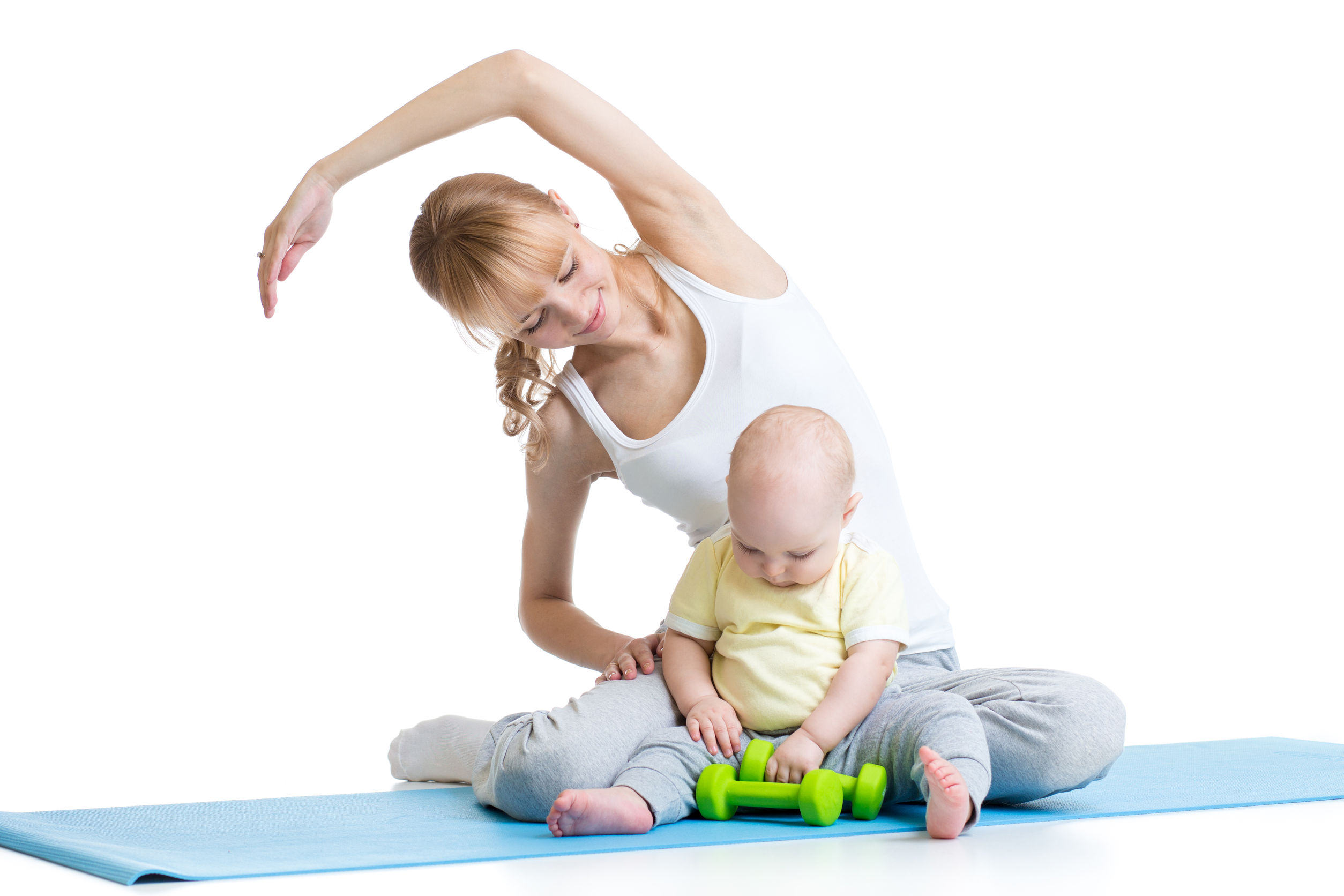 A mother exercising while her baby plays nearby